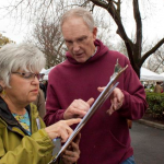 Debra Abbot and Karl Ory, Friends of Farmers' Market organizers, look over signed petitions. Photo by Karen Laslo
