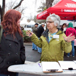 Friends of Farmers' Market organizer, Debra Abbot, explains why it's important to sign the petition. Photo by Karen Laslo