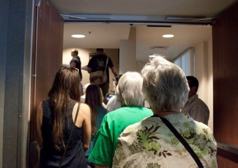 FFM supporters carry the Petitions upstairs to the 3rd floor, City Clerk's Office.