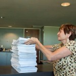 Cheryl King, FFM, stacks the Petitions on the City Clerk's counter.